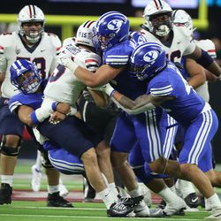 Arizona Wildcats quarterback Will Plummer (15) is sacked by the BYU defense during the Vegas Kickoff Classic in Las Vegas on Saturday, Sept. 4, 2021.