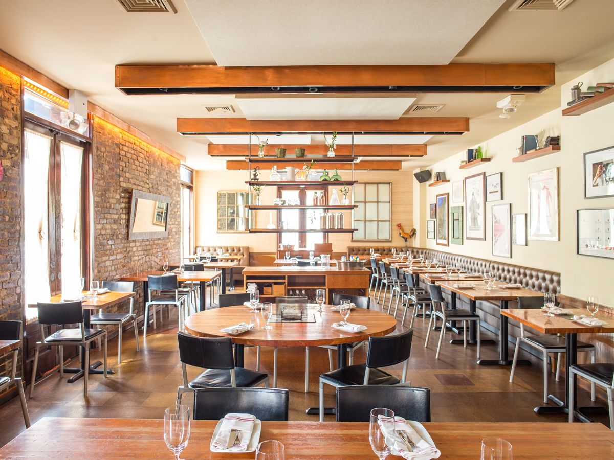 Hearth's dining room with wooden beams on the ceiling and exposed brick walls