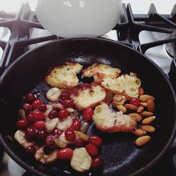 A warm, hearty breakfast on the cold morning today! What to do with some two-day old bread, overripe banana, leftover fresh cranberries, raw almonds and few drops of extra virgin olive oil!