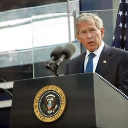 In this Sept. 11, 2011 file photo, former U.S. President George W. Bush addresses those attending the 10th anniversary commemoration of the terrorist attacks on the World Trade Center in New York. For the first time, elected officials won't be allowed to speak Tuesday, Sept. 11, 2012, at  an occasion that has allowed them a solemn turn in the spotlight, a change made in the name of avoiding politics, but rapped by some as a political move in itself.