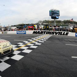 Ryan Newman crosses the finish line to win the NASCAR Sprint Cup Series auto race Sunday, April 1, 2012, in Martinsville, Va.