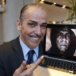 """Moroccan actor Mehdi Ouazzani poses  with a frame from his role during an interview with the Associated Press in Casablanca, Morocco Monday, April, 1, 2013. Ouazzani isn't the devil, but he has played one on TV, only he didn't realize that some thought he looked like US President Barack Obama while he was at it. Ouazzani was bemused to wake up one morning and find that his role in The History Channel's popular five-part mini-series """"The Bible"""" had become the latest way for conservative commentators in the United States to needle the president."""