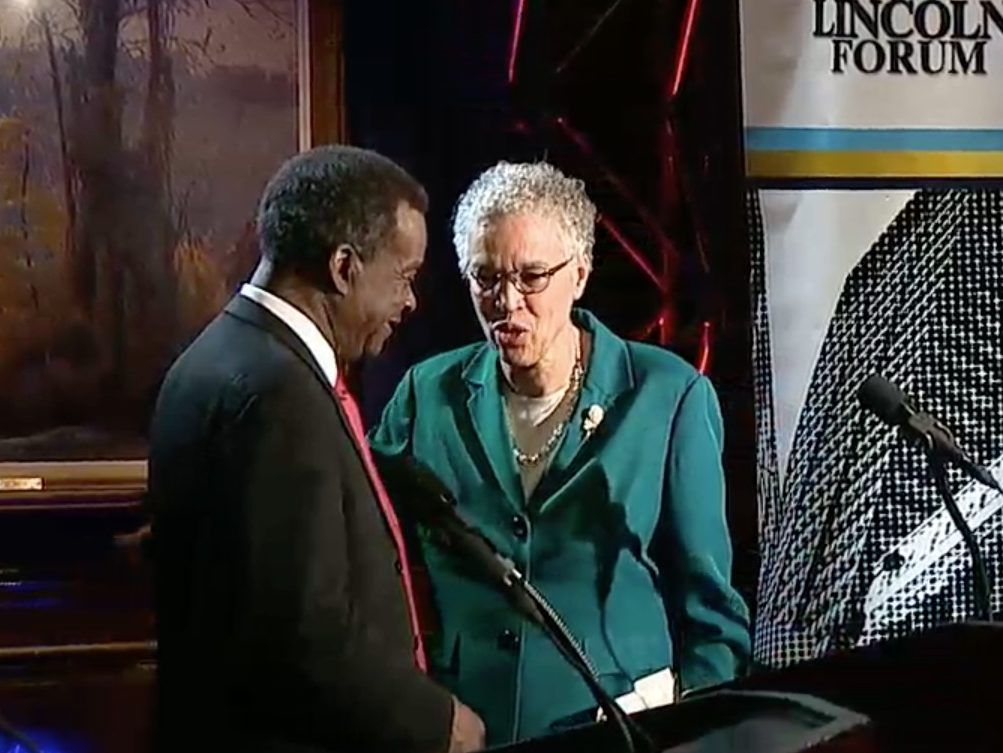 Mayoral candidates Willie Wilson and Toni Preckwinkle talk after Thursday's debate. Screen image.