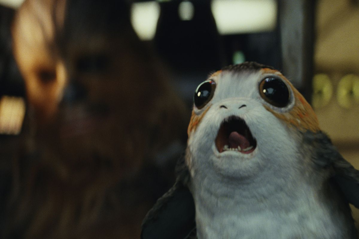 """This image released by Lucasfilm shows Chewbacca, left, and a Porg in a scene from """"Star Wars: The Last Jedi."""""""