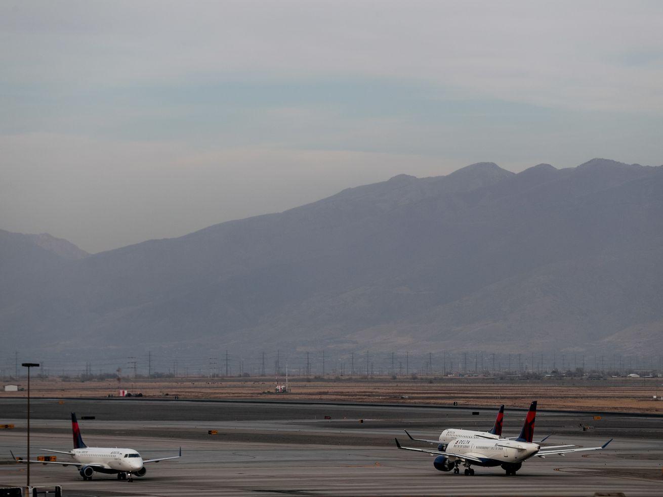 Delta aircraft taxi at Salt Lake International Airport in Salt Lake City. A Delta flight from Atlanta had to make an emergency landing in Salt Lake City Monday