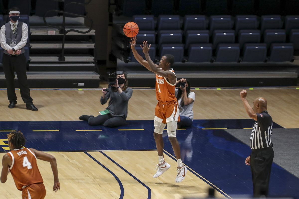 Texas Longhorns guard Andrew Jones (1) shoots a three pointer late in the second half against the West Virginia Mountaineers at WVU Coliseum.