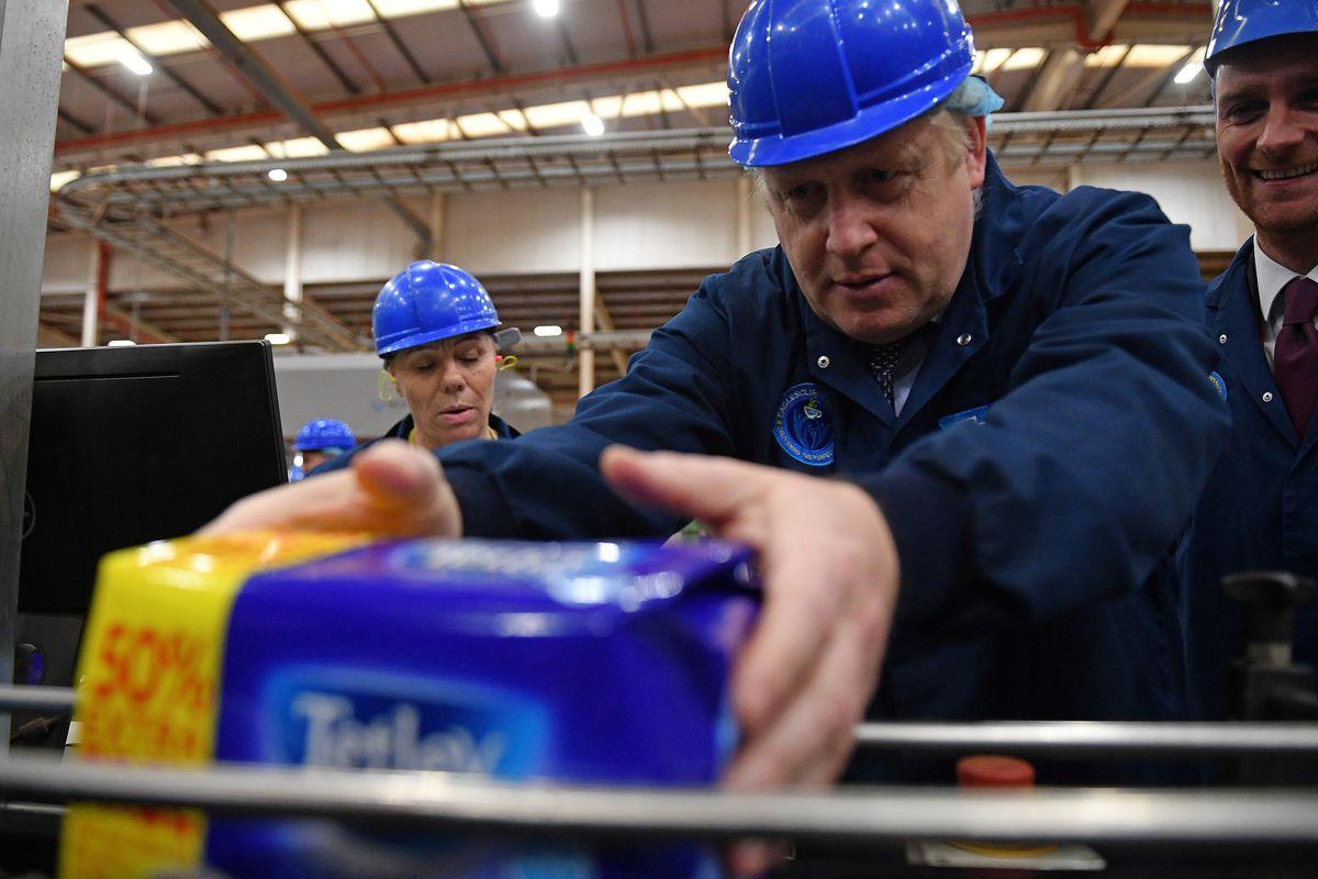 Boris Johnson weighing teabags in 2019