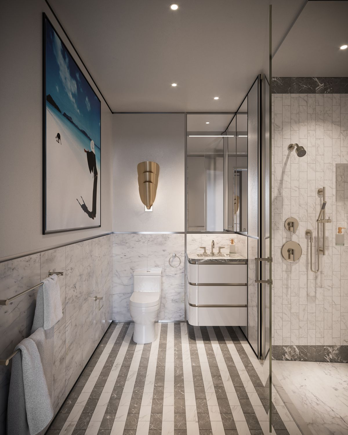 A bathroom with marble floors and finishes.