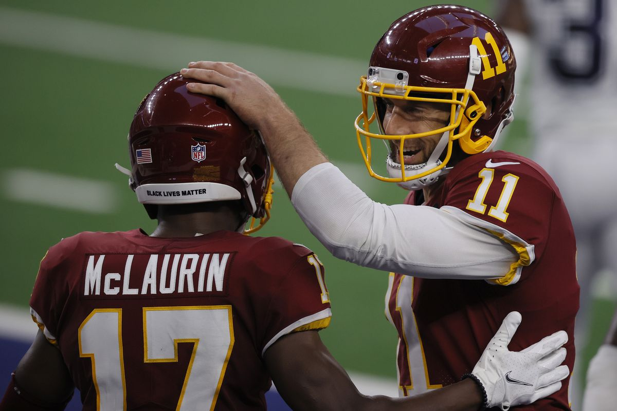 Alex Smith #11 of the Washington Football Team celebrates with Terry McLaurin #17 during the second quarter of a game against the Dallas Cowboys at AT&T Stadium on November 26, 2020 in Arlington, Texas.