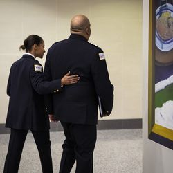 Chicago Police Department Supt. Eddie Johnson's wife puts her arm around her husband after he announced his retirement during a press conference at CPD headquarters, Thursday morning, Nov. 7, 2019.