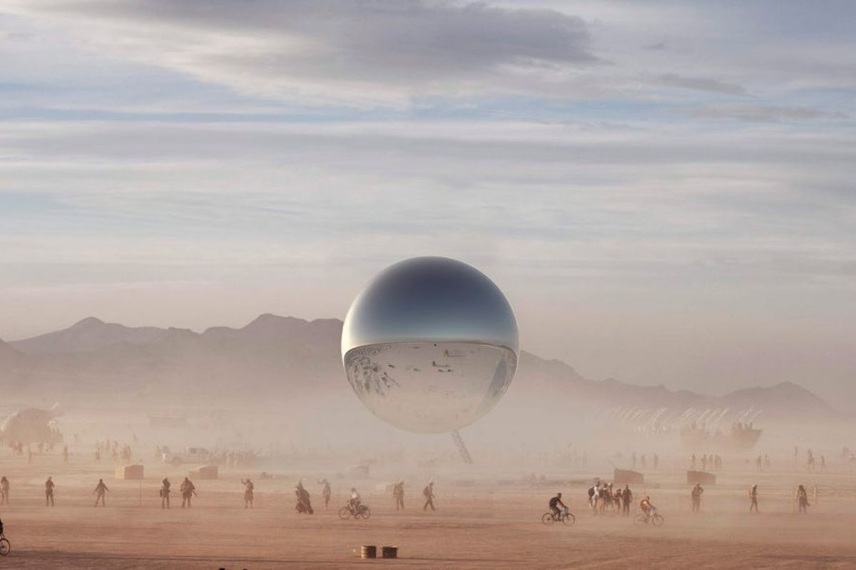 A rendering has the giant reflective orb sitting in the middle of the dusty Black Rock Desert as Burning Man attendees pass by. The structure will stretch 84 feet in diameter.