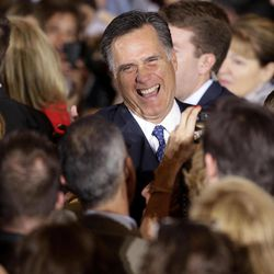 Republican presidential candidate, former Massachusetts Gov. Mitt Romney smiles as he greets supporters at his election night rally in Schaumburg, Ill., Tuesday, March 20, 2012. Romney won Illinois primary.
