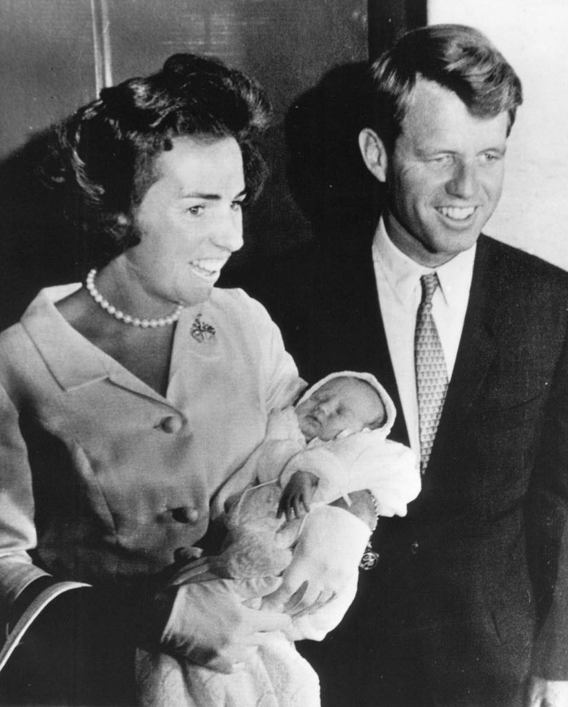 Ethel Kennedy and her husband, the then-Attorney General Robert F. Kennedy, beam with pride as they leave St. Elizabeth's Hospital in Boston in 1963 with baby Chris for their Hyannis Port summer home. | File photo