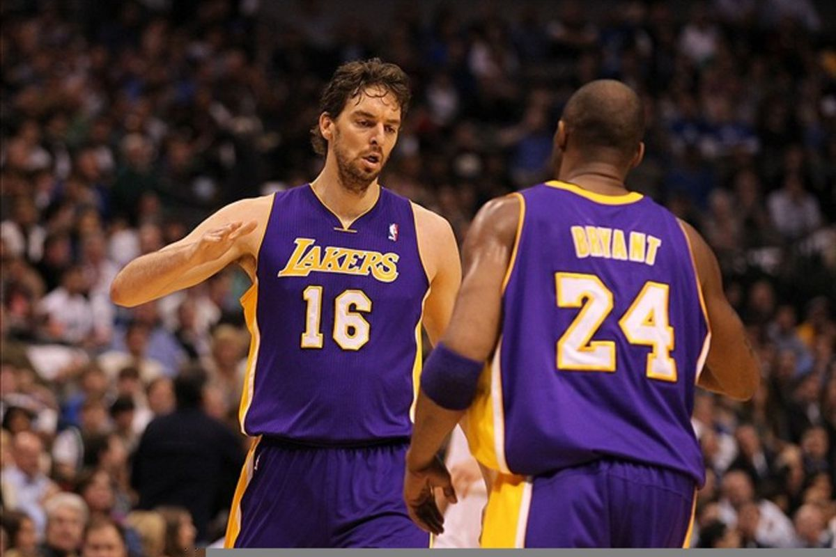 Feb 22, 2012; Dallas, TX, USA; Los Angeles Lakers forward Pau Gasol (16) celebrates with guard Kobe Bryant (24) in the first quarter against the Dallas Mavericks at American Airlines Center.  Mandatory Credit: Matthew Emmons-US PRESSWIRE