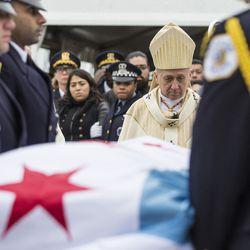 Cardinal Blase Cupich watches as pallbearers carry the casket. | Ashlee Rezin/Sun-Times