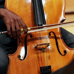 Getro Joseph, a young cellist from Haiti, plays his music as he plays with John Eckstein of the Utah Symphony during a short practice session at Abravanel Hall in Salt Lake City on Saturday, Dec. 7, 2019. Getro also met with Congressman Ben McAdams, who assisted Getro with the visa process for his trip to Utah.