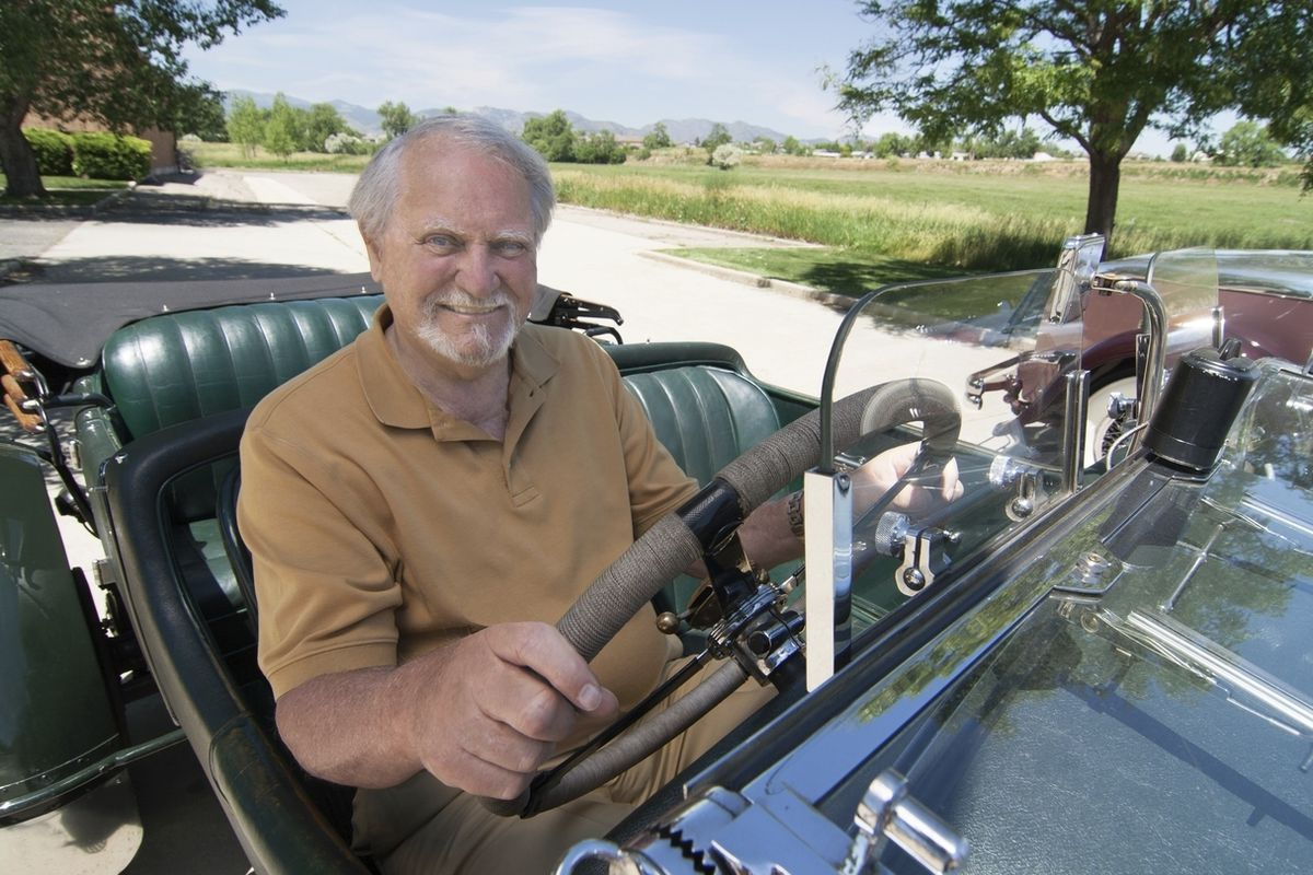 Famed author Clive Cussler riding in a classic car. Cussler died on Monday at his home in Scottsdale, Arizona. He was 88.