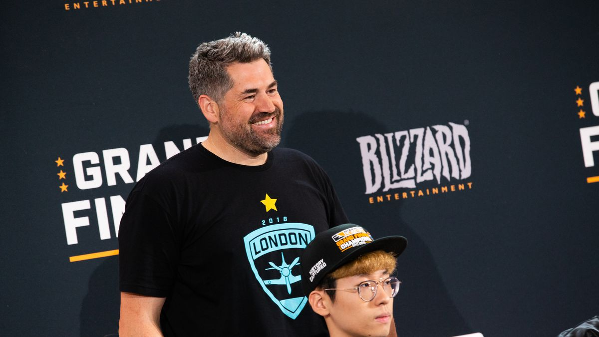 Jack Etienne stands at a Overwatch League Grand Finals press conference behind the London Spitfire