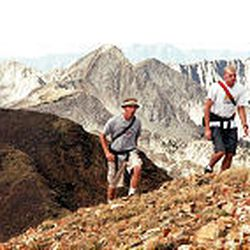 Matt Callan and Cameron Ward of Farmington, who are attending schools in Orem and Provo, climb toward the summit of the American Fork Twin Peaks, elevation 11,433 feet, in the Wasatch Mountains.