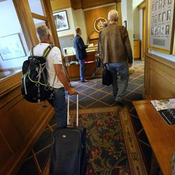 Libertarian presidential candidate Gov. Gary Johnson and running mate Gov. Bill Weld walk into the Alta Club in Salt Lake City before giving a speech at the University of Utah on Saturday, Aug. 6, 2016.