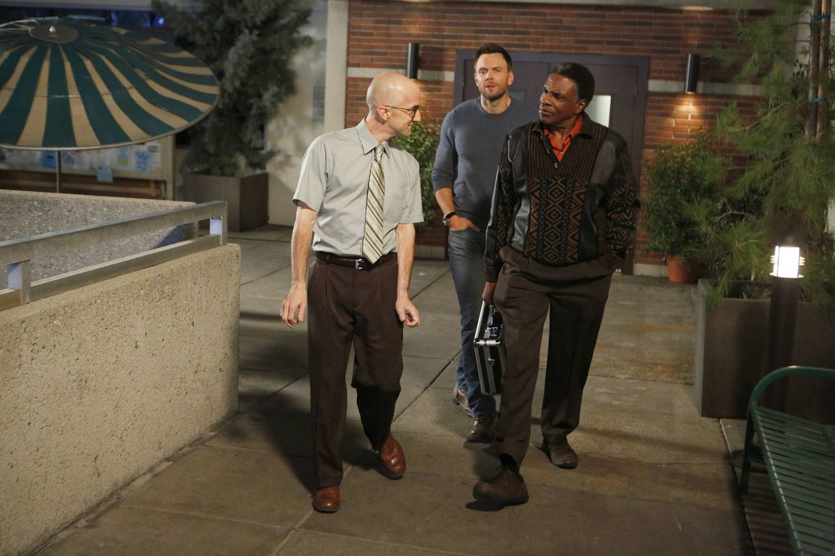 Dean Pelton (Jim Rash, left) and Jeff Winger (Joel McHale) bid farewell to their new acquaintance Elroy (Keith David). This being television, it won't be for long.