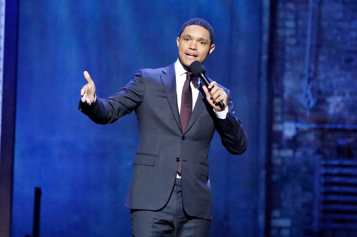 """Trevor Noah performs Monday during the first of the """"Daily Show"""" episodes recorded at the Athenaeum Theatre in Chicago in 2017.  Jeff Schear/Getty Images"""