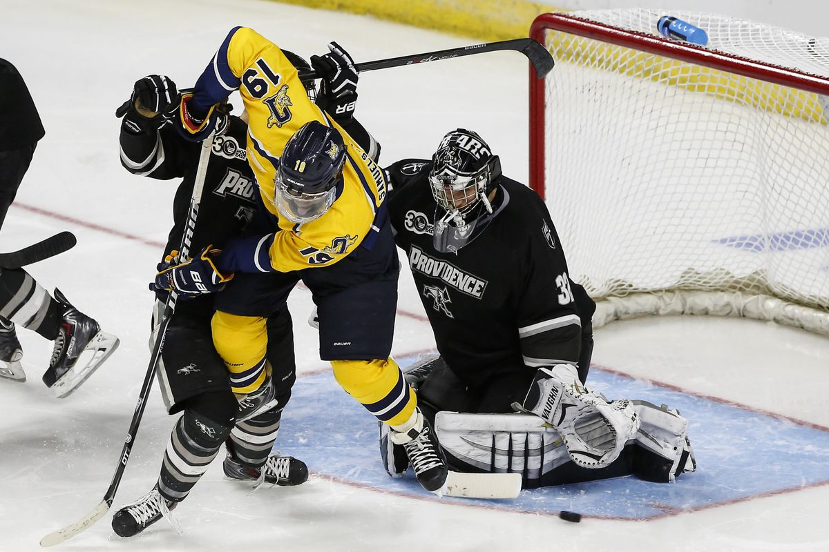 Jon Gillies makes a stop with Jordan Samuels-Thomas looking to screen the Friars goaltender.