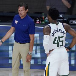 Utah Jazz's head coach Quin Snyder, left, speaks with Donovan Mitchell (45) during the first half of an NBA basketball game against the Oklahoma City Thunder, Saturday, Aug. 1, 2020, in Lake Buena Vista, Fla.