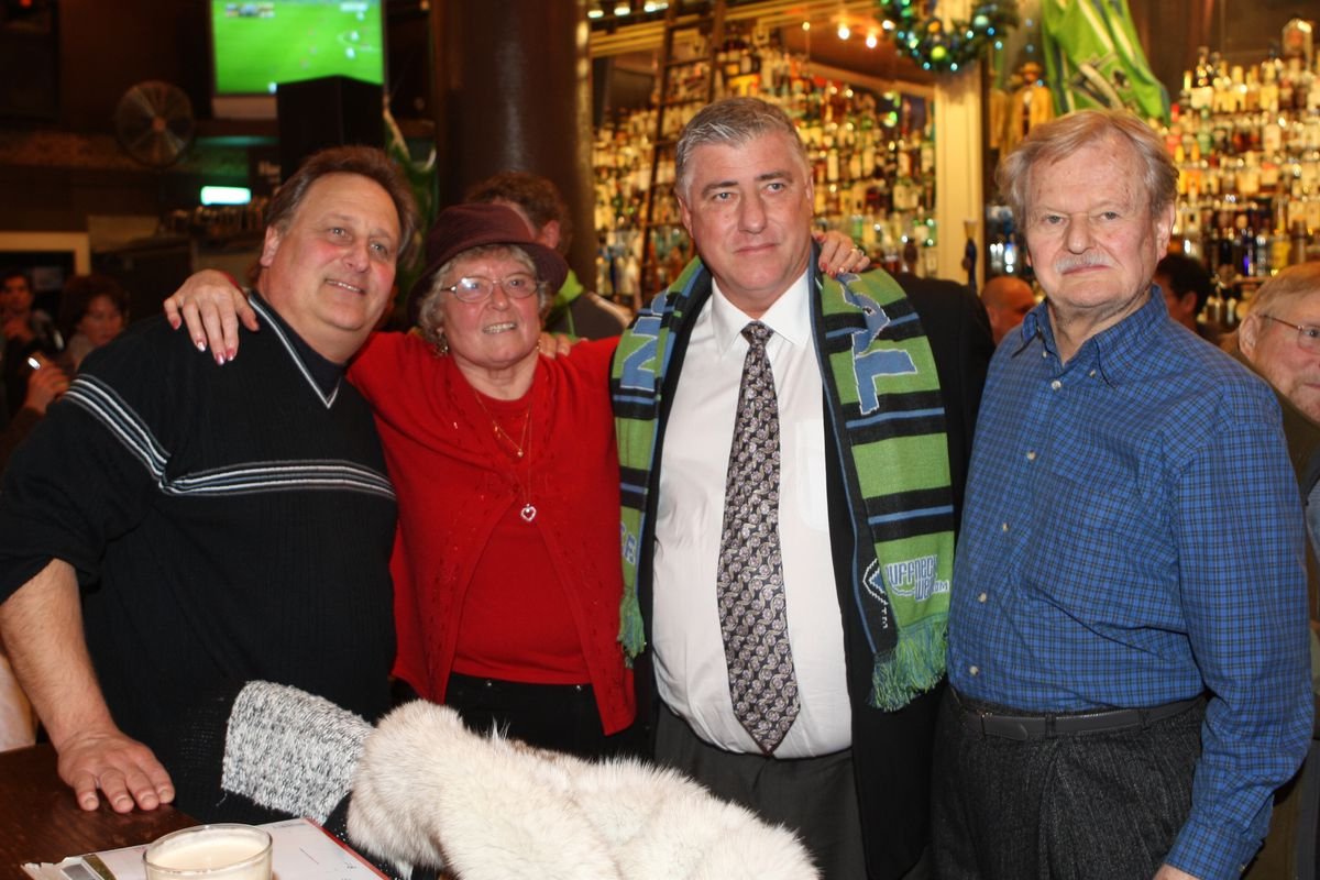 Sigi Schmid celebrated his first night as Sounders FC coach at F.X. McRory's. Here he is joined by the family of Hans Stierle, a Vashon Island resident and also his first youth coach.