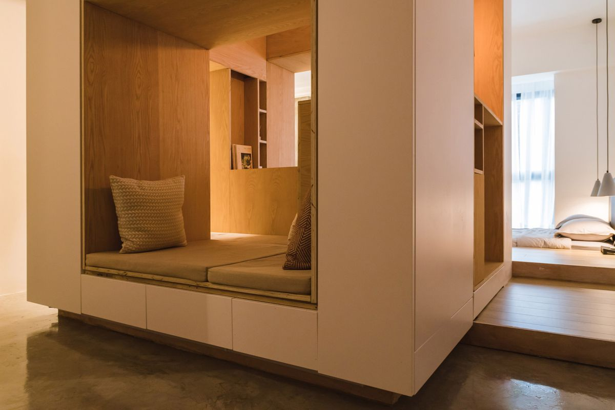 Cube seating area in middle of apartment.