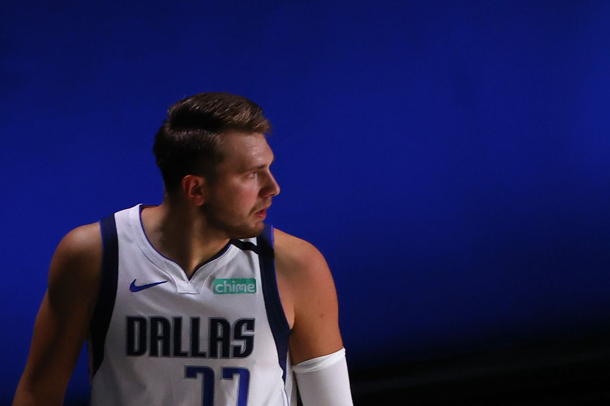 Luka Doncic of the Dallas Mavericks looks back at Marcus Morris Sr. of the LA Clippers after being fouled during the first quarter in Game Six of the Western Conference First Round during the 2020 NBA Playoffs at AdventHealth Arena at ESPN Wide World Of Sports Complex on August 30, 2020 in Lake Buena Vista, Florida.