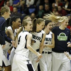 Timpanogos celebrates after Mercedes Riggs made a long 3-poin-shot to end the first half as Timpanogos High School defeats Springville High School 62-47 to win the 4A Girl's Championship basketball game Saturday, Feb. 25, 2012, in Taylorsville, Utah.