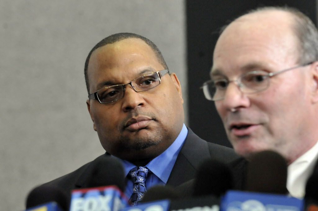 """Then-Ald. Isaac """"Ike"""" Carothers listens to his lawyerJeffrey Steinback as Steinbeck speaks to the media after Carothers pleaded guilty to federal corruption charges in 2010. File Photo. Brian Jackson/Chicago Sun-Times"""