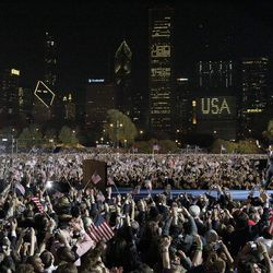 Barack Obama walks on stage with his family to speak at his election night party in Grant Park. | AP photo