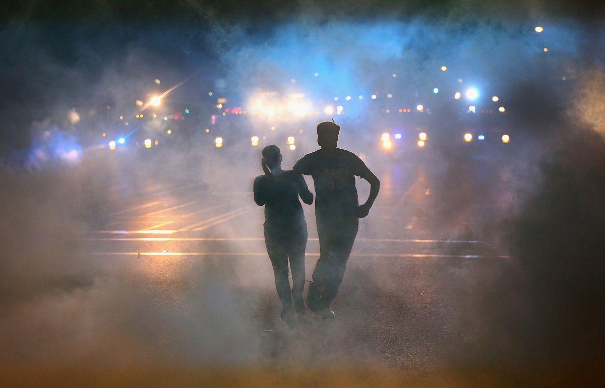 Protesters fleeing tear gas Ferguson