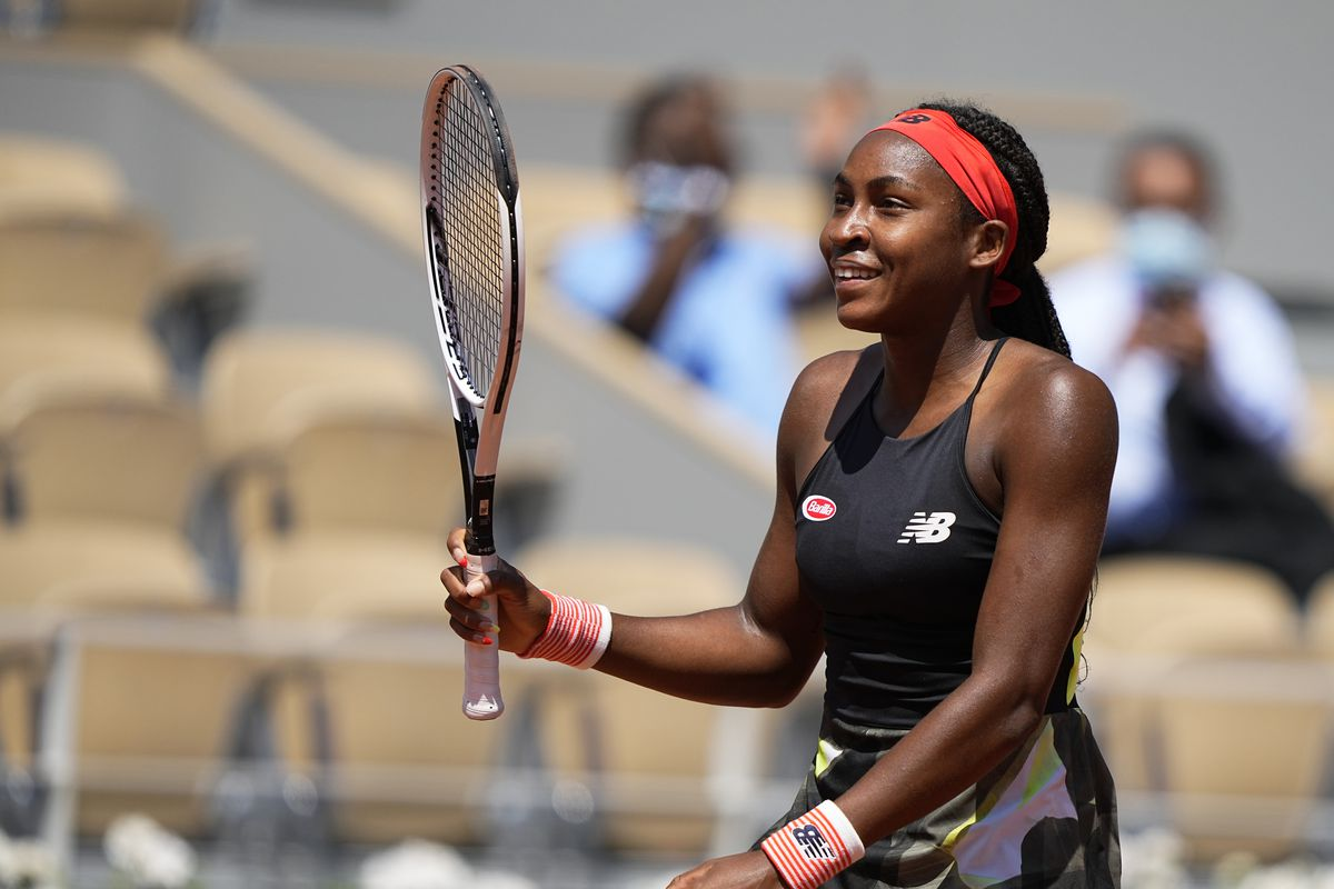 Coco Gauff celebrates after defeating Ons Jabeur during their fourth round match at the French Open.
