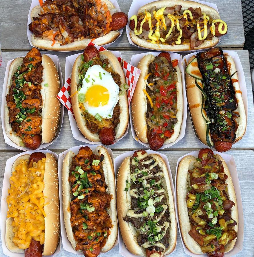 Ten hot dogs with various toppings