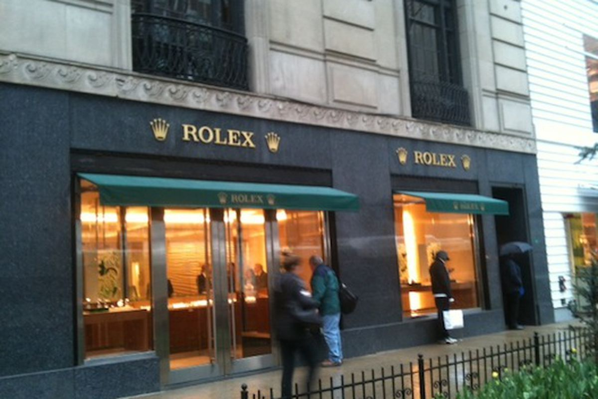 yesterday at about 310pm the rolex store on michigan ave opened its doors the store design takes cues from the oyster perpetual watch and is