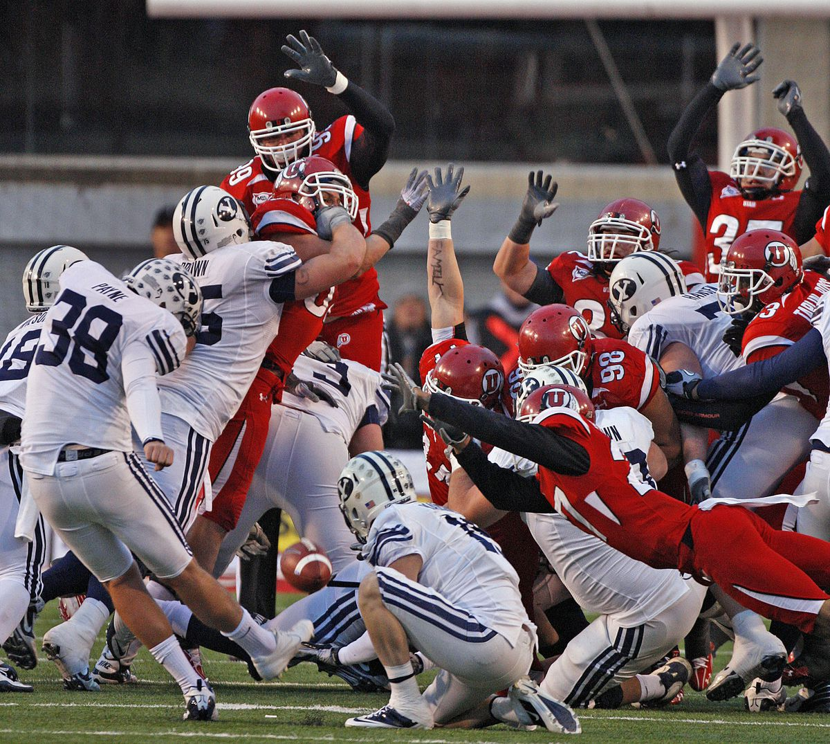 Utah's Brandon Burton (lower right) blocks BYU's Mitch Payne's field goal attempt in the final seconds as the University of Utah beat BYU 17-16 in MWC football action Saturday, Nov. 27, 2010, in Salt Lake City.