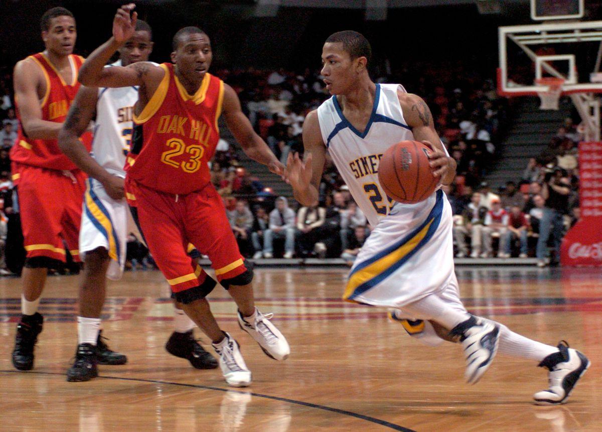 Simeon guard Derrick Rose blows by Oak Hill guard Nolan Smith.