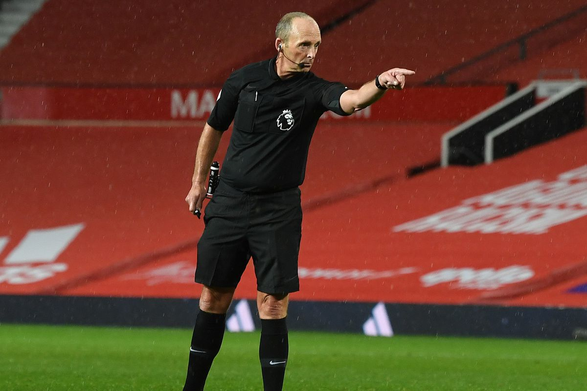Referee Mike Dean points to the penalty spot - Premier League