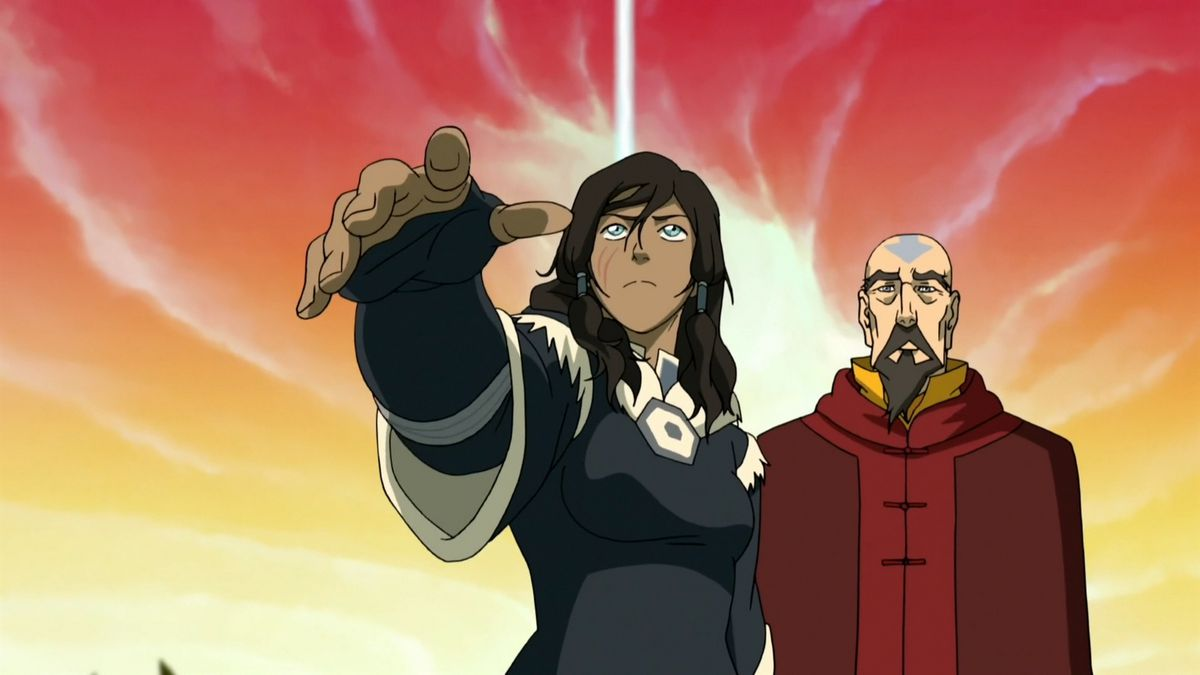Korra extends a hand toward the camera as she and Tenzin stand in front of a brilliant yellow and red sky in Legend of Korra