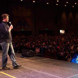 Nathan Fillion addresses a capacity crowd at Salt Lake Comic Con FanXperience.