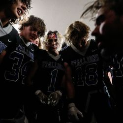 Stansbury players listen to their coach before a celebratory team song after winning a high school football game against Tooeleat Stansbury High School in Stansbury Park on Friday, Sept. 17, 2021.