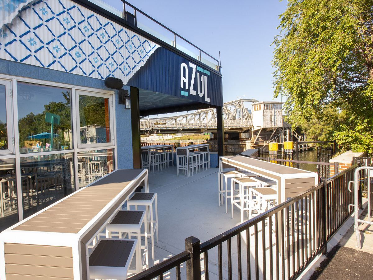 An outdoor restaurant with glassy walls