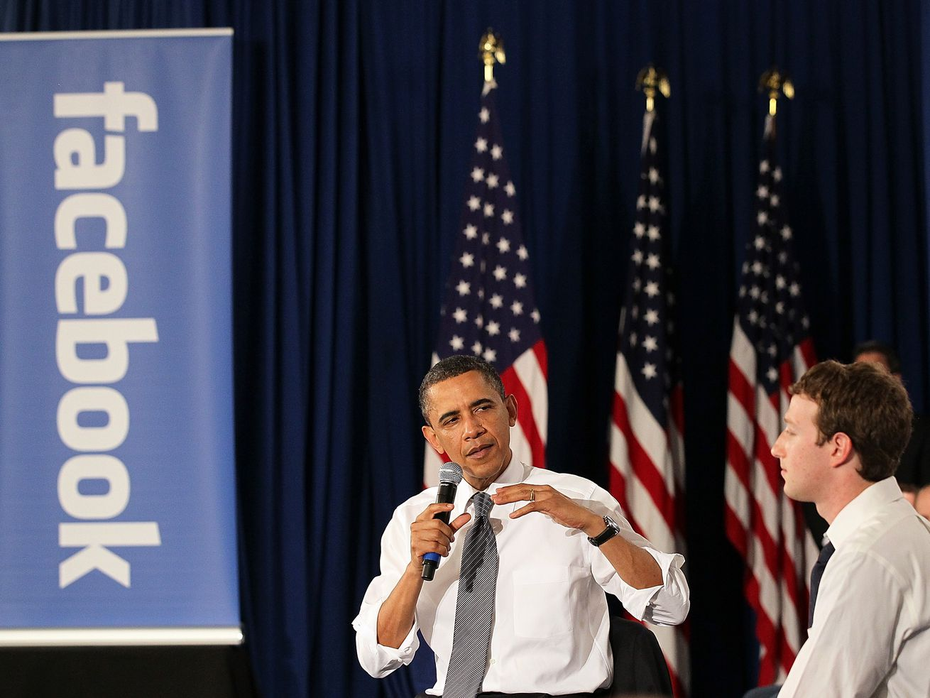 Mark Zuckerberg and Barack Obama holding a town hall in 2011.
