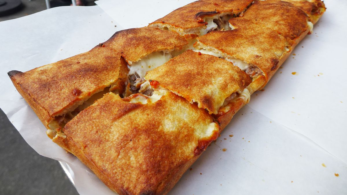 A rectangular pizza with a browned top crust.