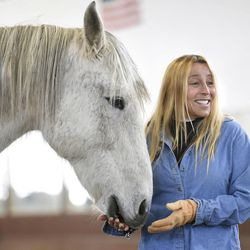 Hayley Sumner, executive director and founder of Berkshire HorseWorks, stands with Zephyr during an Equine Assisted Psychotherapy open house on Saturday, March 18, 2017, at Berkshire Equestrian Center in Richmond, Mass.