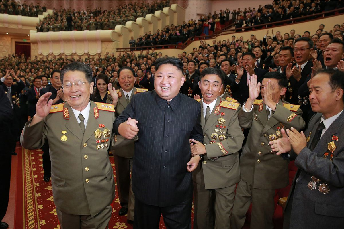 """This undated picture released by North Korea's official Korean Central News Agency (KCNA) on September 10, 2017 shows North Korean leader Kim Jong-Un (front 2nd L) attending an art performance dedicated to nuclear scientists and technicians, who worked on a hydrogen bomb which the regime claimed to have successfully tested, at the People's Theatre in Pyongyang. / AFP PHOTO / KCNA VIA KNS / STR / South Korea OUT / REPUBLIC OF KOREA OUT   ---EDITORS NOTE--- RESTRICTED TO EDITORIAL USE - MANDATORY CREDIT """"AFP PHOTO/KCNA VIA KNS"""" - NO MARKETING NO ADVERTISING CAMPAIGNS - DISTRIBUTED AS A SERVICE TO CLIENTS"""