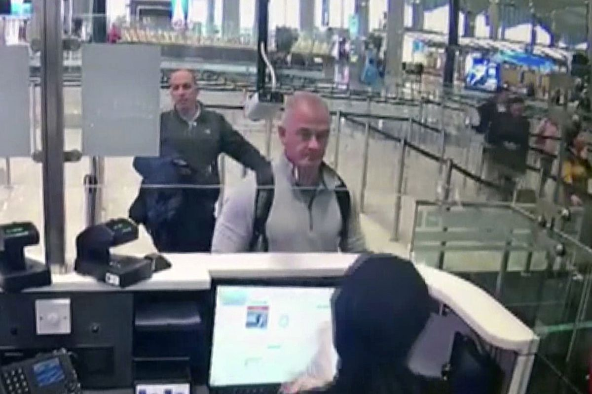 This Dec. 30, 2019 image from security camera video shows Michael L. Taylor, center, and George-Antoine Zayek at passport control at Istanbul Airport in Turkey. Taylor is accused of smuggling former Nissan Motor Co. Chairman Carlos Ghosn out of Japan in 2019 while he was awaiting trial on financial misconduct charges.